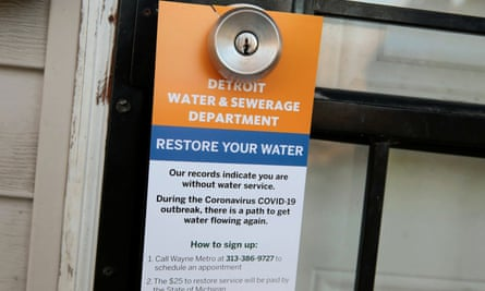 A notice by the Detroit Water and Sewerage Department informs residents how to restore service. But many residents say they have not been told the shutdown has been lifted.