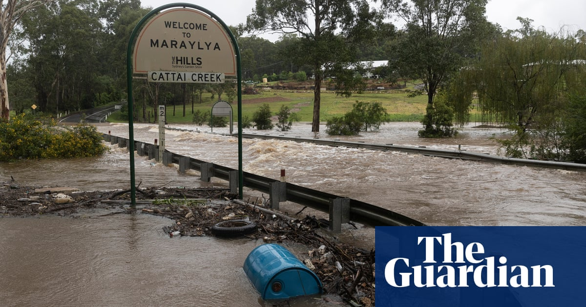 First fatality of NSW floods as man dies after car swept into creek in Sydney's north-west