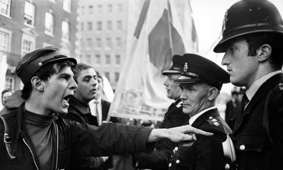 A protester confronts police at an anti-Vietnam war demonstration in Grosvenor Square, London, June 1966