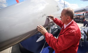 The Turkish president, Recep Tayyip Erdoğan, signs a Bayraktar Akıncı drone at an aerospace festival in Istanbul this month.