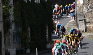 The pack rides in late French cyclist Raymond Poulidor's hometown Saint-Leonard-de-Noblat during the 12th stage between Chauvigny and Sarran.