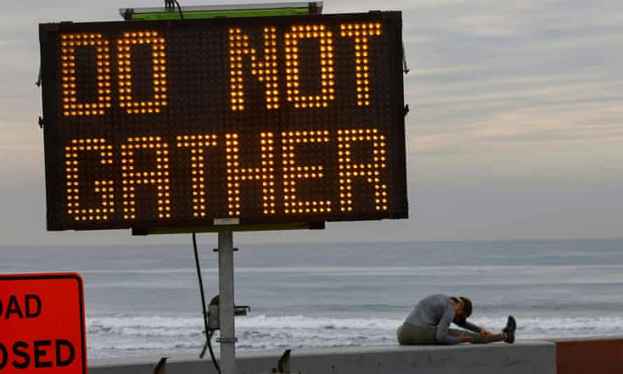 A warning sign on the beach as new stay-at-home orders begin in southern California.