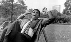 Relaxing in a London park the day after his 1966 defeat of Henry Cooper.