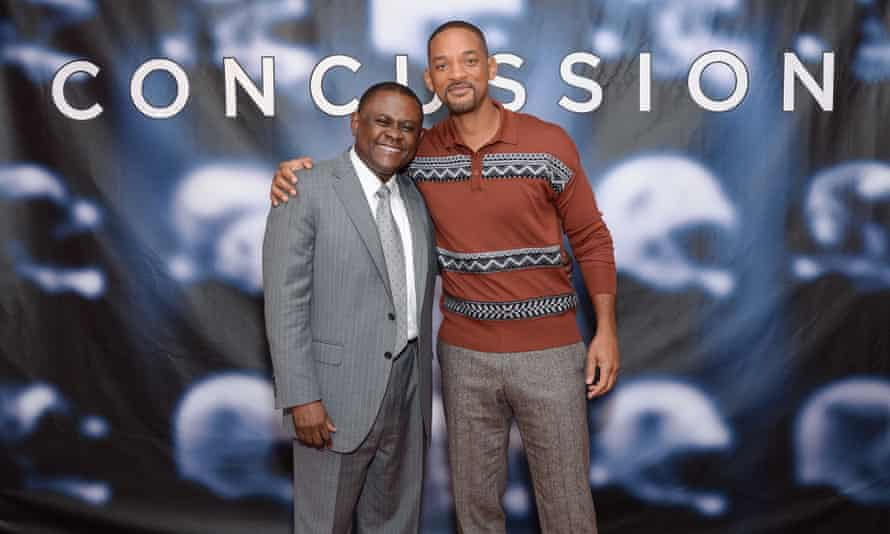 Dr Bennet Omalu and actor Will Smith at a photocall for the documentary Concussion.