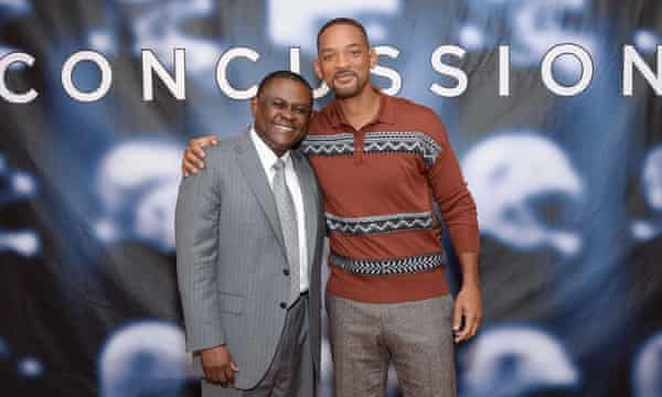 "Bennet Omalu, Will Smith<br>Dr. Bennet Omalu, left, and actor Will Smith pose together at the cast photo call for the film ""Concussion"" at The Crosby Street Hotel on Monday, Dec. 14, 2015, in New York. (Photo by Evan Agostini/Invision/AP)"