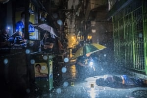 General news – stories, first prize Police inspect an alley where a victim was killed by two unidentified gunmen in Manila, Philippines