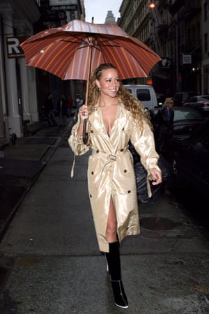 Singing in the rain in a gold trench coat in New York.