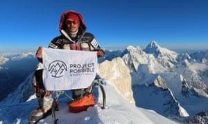 Nirmal 'Nims' Purja stands at the summit of Gasherbrum II