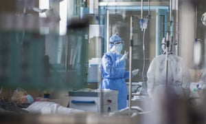 Nurses in a specialised ICU ward for patients infected by coronavirus in Wuhan, Hubei province, China.