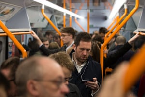 Commuters standing on a train into central London.