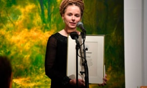 Swedish culture and democracy minister Amanda Lind unveils the Swedish PEN's Tucholsky prize to Chinese-Swedish book publisher Gui Minhai.