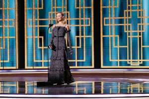 Margot Robbie presents during the ceremony