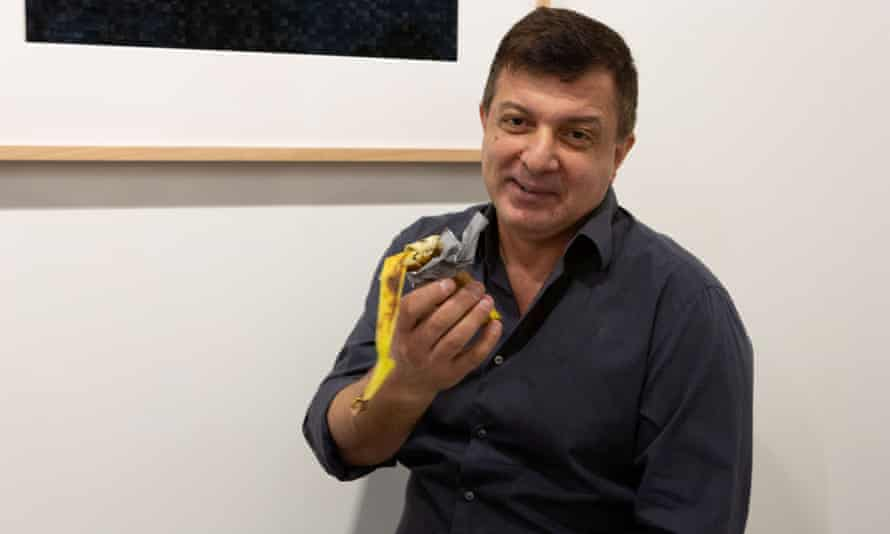 David Datuna shows the remains of the artwork Comedian'by the artist Maurizio Cattelan.