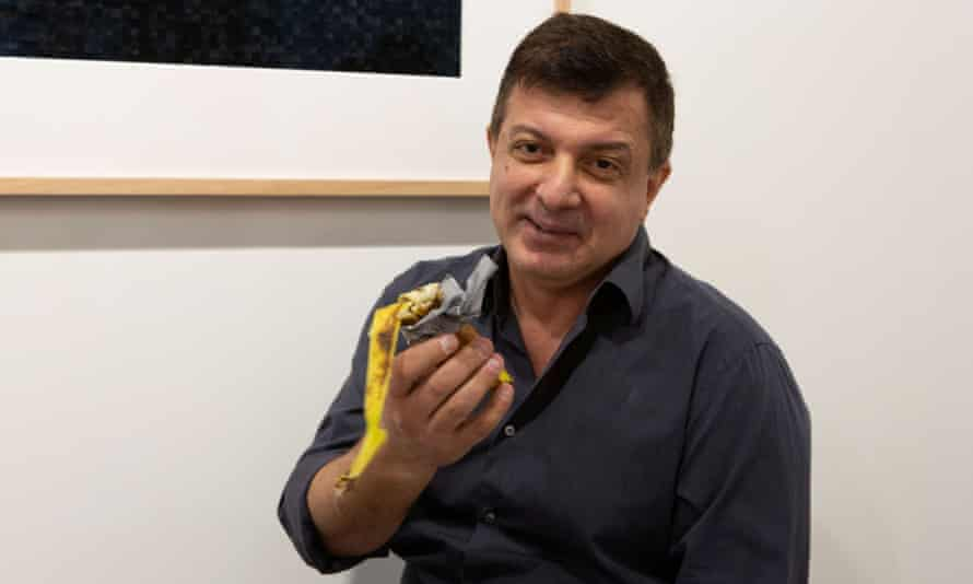 David Datuna shows the remains of the artwork Comedian by Maurizio Cattelan at Perrotin in Art Basel in Miami