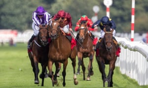 Bondi Beach, ridden by Colm O' Donoghue, purple cap, and Simple Verse, ridden by Andrea Atzeni, clash during the St Leger at Doncaster in September.