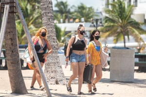 Beachgoers enjoy a sunny day on the beach in Fort Lauderdale, Florida despite a record high number of new Covid-19 cases in the state this week, on 25 July, 2020.