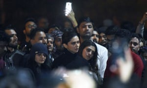 Deepika Padukone (centre) joined protesters at Jawaharlal Nehru University in Delhi, where staff and students were injured by a masked mob on Sunday.