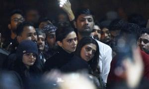 The actor Deepika Padukone, centre, visits students protesting at Jawaharlal Nehru University (JNU) in Delhi.