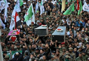 Mourners carry the coffin of Iran-backed Popular Mobilisation fighters killed in the U.S. airstrike in Qaim, during their funeral in Najaf, Iraq.