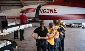 HSUS members watch as the last dogs are loaded onto a plane.