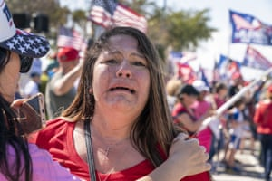 Florida, USA woman reacts after seeing former President Donald Trump pass by in his motorcade. People lined the street in West palm beach on President's Day to show support for Mr. Trump.