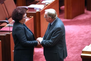 Jacinta Collins is congratulated by Ian Macdonald after giving her valedictory speech