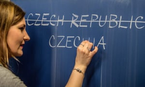 A schoolteacher writes a possible new English name for the Czech Republic on a blackboard in Prague on Thursday.