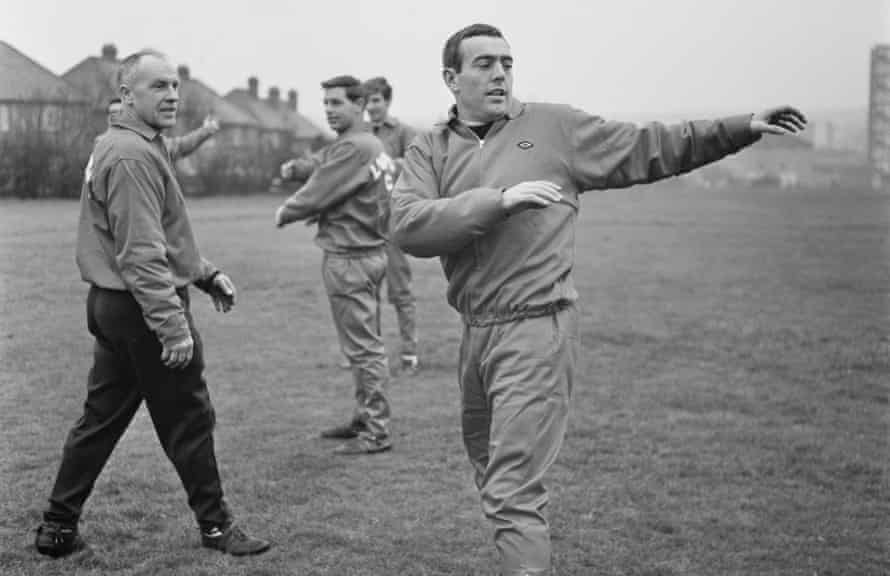 Ian St John warms up, watched by Liverpool's manager Bill Shankly in January 1967