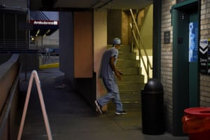 Houston, Texas. A healthcare worker walks through a parking garage during a shift change as cases of the coronavirus disease spike the state
