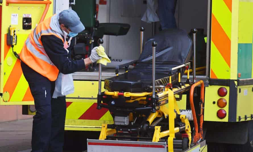An NHS worker cleans down an ambulance at Royal London Hospital.