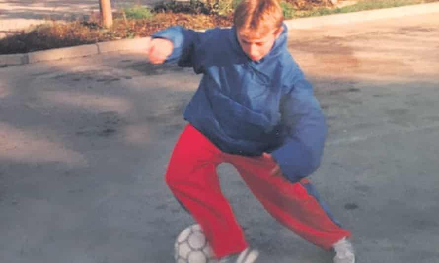 Luka Modric playing football in the car park of the hotel in Zadar where his family were housed after fleeing their home during Croatia's war of independence.