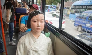 A 'comfort woman' statue installed on a bus in central Seoul, South Korea.