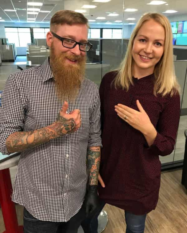 Journalist Olivia Solon poses with piercer Andy after getting the microchip implant.