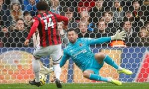 Watford's Ben Foster saves a shot from Bournemouth's Arnaut Danjuma.