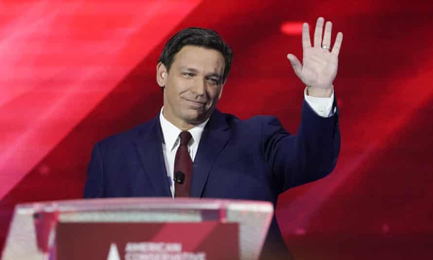 Ron DeSantis waves as he is introduced at CPAC in Orlando, Florida, on 26 February.