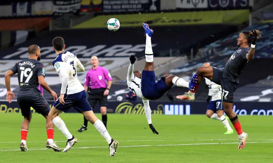 Tanguy Ndombele beats Brentford's Ivan Toney as Tottenham defended their lead.