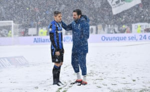 Atalanta's Rafael Toloi (L) and Juventus' Gianluigi Buffon talk prior to the Italian Serie, a soccer match between Juventus FC and Atalanta at Allianz Stadium in Turin, Italy. The match was postponed due to a heavy snow fall in Turin.