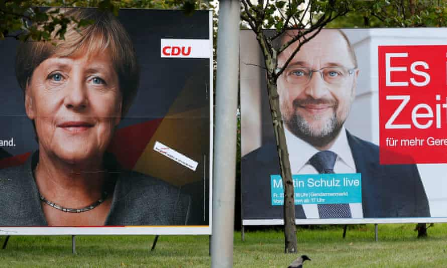 Election campaign posters of the CDU and SPD for the upcoming general elections are pictured in Berlin.
