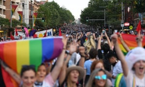 Revellers march down Oxford Street in Sydney after the announcement of the same sex marriage vote result, 15 November 2017.