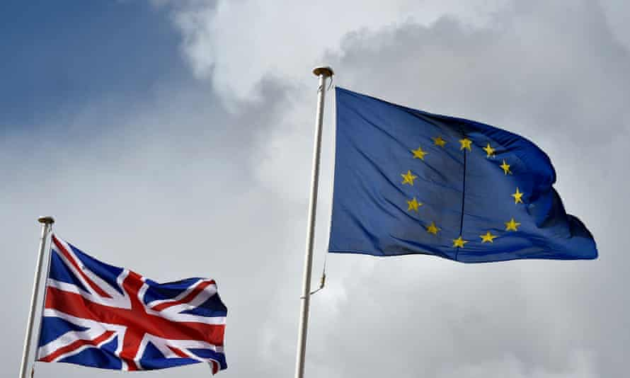 Britain's union jack flutters alongside the EU flag