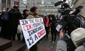 About 30 pro-Beyoncé and Black Lives Matter supporters waited outside the NFL's headquarters, holding signs proclaiming 'Get information' and 'Pro black doesn't mean anti white'.