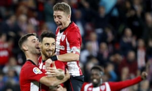 Aritz Aduriz (centre) is congratulated after his penalty against Valladolid.