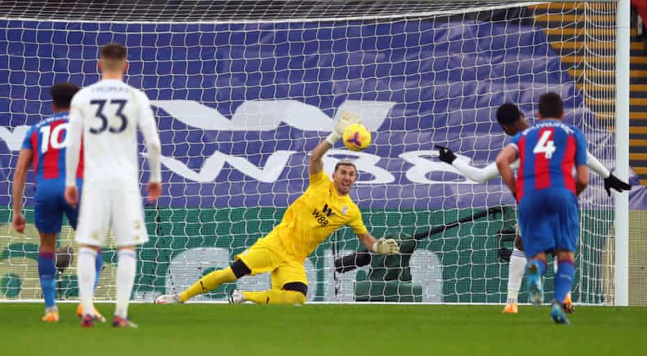 Crystal Palace goalkeeper Vicente Guaita dives to his left to deny Leicester City's Kelechi Iheanacho from the penalty spot.