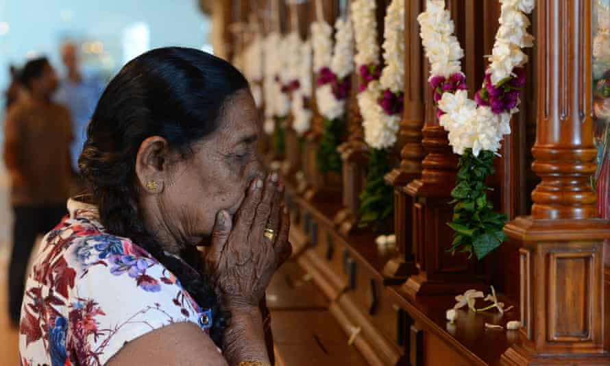 A woman prays at a church in Sri Lanka targeted in bombings on Easter Sunday
