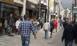 People shop in the high street in Douglas, Isle of Man.