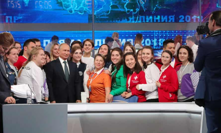 President Putin poses for a group photo with volunteers after his annual televised Q&A session.