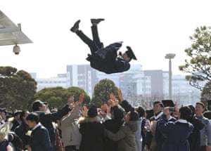 A university graduate is thrown into the air in Seoul, South Korea