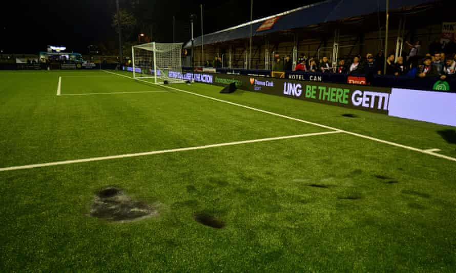 The plastic pitch at Hyde's Ewen Fields was damaged by a flare, causing a delay to kick-off.