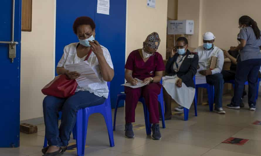 South African health workers await their Covid-19 vaccine.