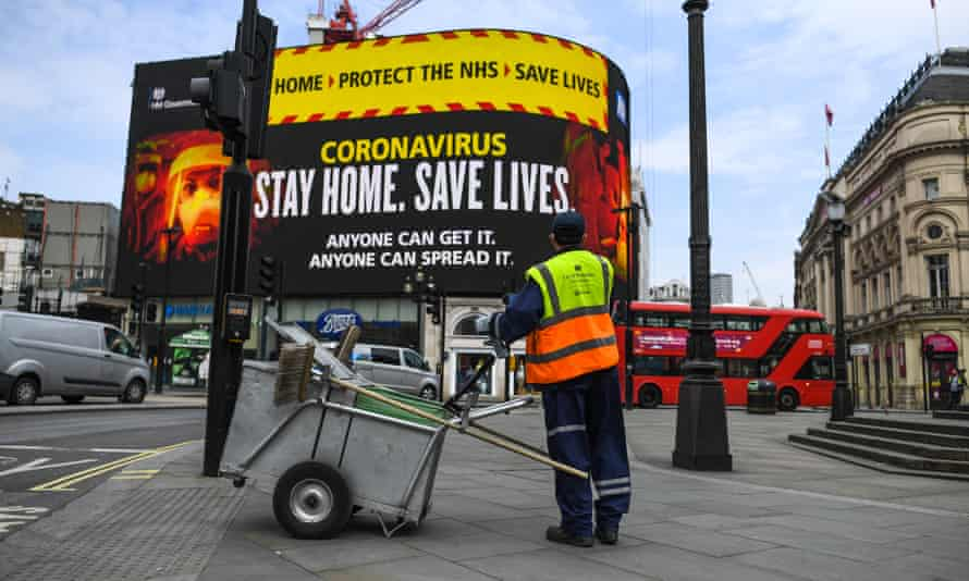 A street cleaner at Piccadilly Circus, London.